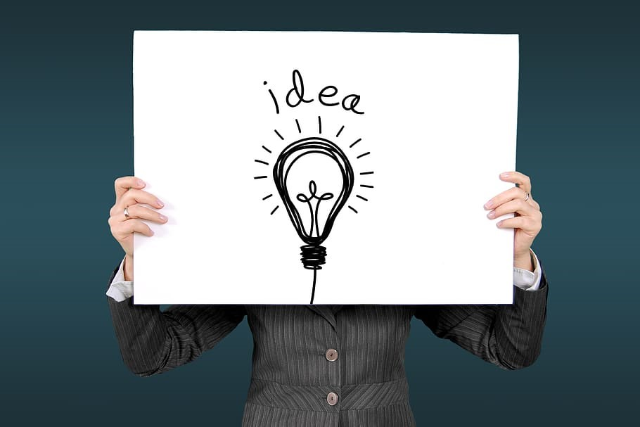 Person holding up a sign with a light bulb | Kings Patent & Trade Marks Attorneys