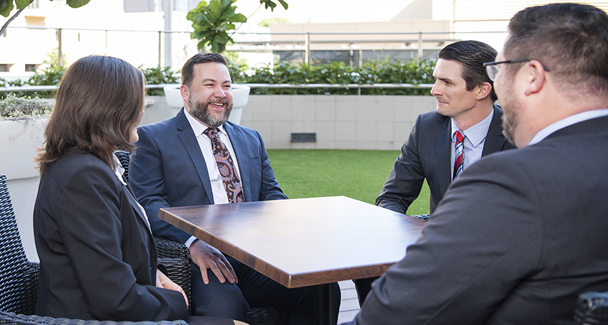 The Kings IP team sitting at a table outdoors | Kings Patent & Trade Mark Attorneys