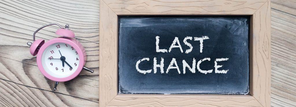 "Alarm clock with mini blackboard saying ""Last Chance""   Kings Patent & Trade Mark Attorneys"