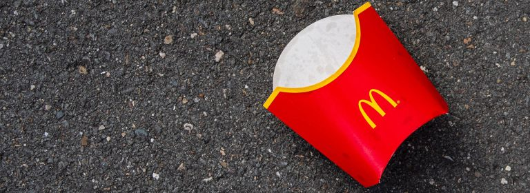 Empty McDonalds chips carton laying on bitumen   Kings Patent & Trade Marks Attorneys